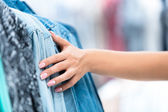 The sliding fingers on the clothes — Stock Photo