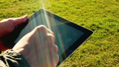 Man using tablet pc outdoors — Stock Video