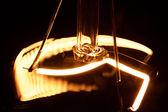 Light bulb gradually turns on and off — Stock Photo