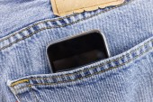 Smartphone in the pocket jeans — Stock Photo