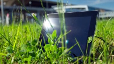 Tablet PC on the Grass — Stock Video