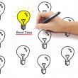 Hand with pen drawing yellow light bulb with good idea word amon — Stock Photo #75131761