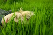 Girl head in the grass — Stock Photo