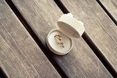 Wedding rings on the wooden floor — Stock Photo