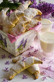 Croissants with milk and lilac — Stock Photo