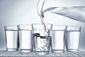 Pouring water — Stock Photo