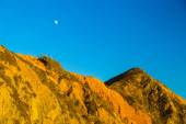 Moon above rocks at Pfeiffer State Park, Big Sur, California — Stock Photo
