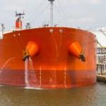 Oil tanker moored near an oil silo in Port of Antwerp — Stock Photo #80438308