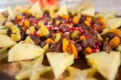Steak kabob appetizer with tropial fruit and pomegranate — Stock Photo