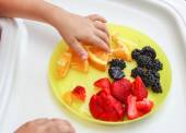 Healthy child and snacking — Stock Photo