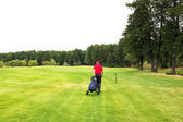 Playing golf on a golf course in cloudy weather — Stock Photo