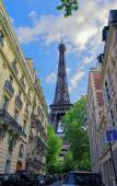 Eiffel Tower between city buildings — Stock Photo