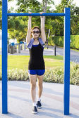Asian woman doing exercises at the park outdoor on  a vertical b — Stockfoto