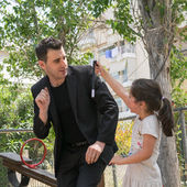 Date: 17-5-2015. Location: Park in Athens Greece. Magic trick wand falls down and brakes suddenly when the kid takes it at a Magic show. — Stock Photo