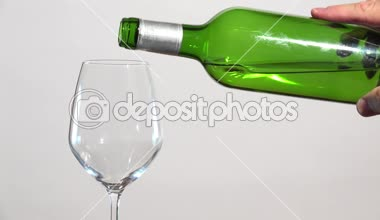 White wine flowing into glass — Stock Video