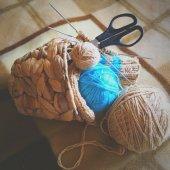 Knitting supplies on beige plaid — Stock Photo