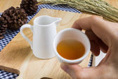 Taking Tea Cup on Wood Texture Background — Stock Photo