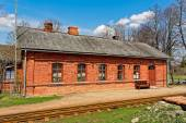 Old red brick railway station building — Stockfoto