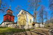 Small wooden church in traditional ochre-red colour — Stock Photo