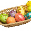 Colorful Easter eggs in wicker basket — Stock Photo #79054832