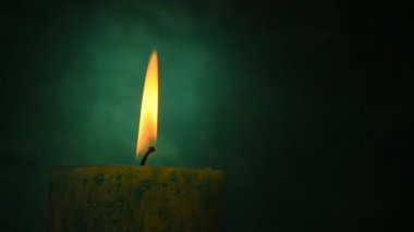 Teal candle trembling flame out of the dark and blown out — Stock Video