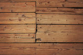 Vintage wooden panel with horizontal planks and gaps with shade — Stock Photo