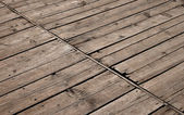 Vintage wooden panel with diagonal planks and gaps — Stock Photo