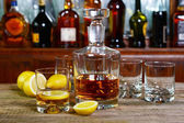 Decanter and glass of whisky — Stock Photo