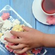 Children hand is taking out of the box meringue. — Stock Photo #77647956
