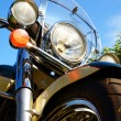 Motorcycle detail closeup front fork and headlight and wheel. — Stock Photo #78229404