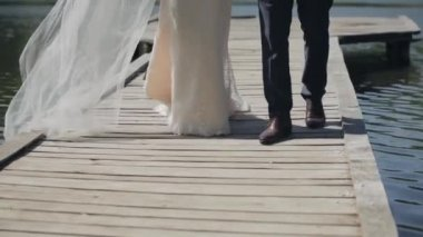 Wedding couple - view from the bottom , legs, go over the bridge — Stock Video