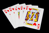 Card Game Hand on Black Background — Stock Photo