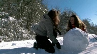 Mom And Daughter Playing In The Snow — Stock Video