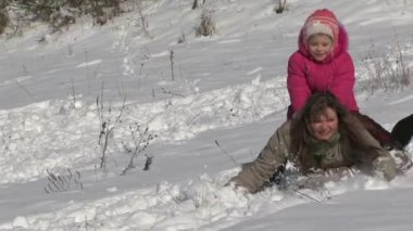 Girl Riding A Mother With A Snow Slide. — Stock Video