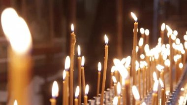 Wax candles burning in the Orthodox Church. There Is The Sound — Stock Video