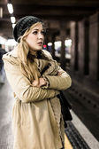 Woman  at the subway station — Stock fotografie