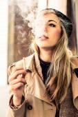 Woman smoking a cigarette — Stock Photo