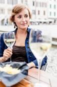 Woman drinking an aperitif — Stock Photo