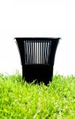 Rubbish bin in the garden — Stock Photo