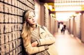 Woman at the subway station — Stock Photo