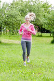 Young slim woman running — Stock Photo