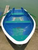 Blue boat with oars on the shore — Stock Photo