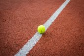 Tennis ball on line of court — Stock Photo