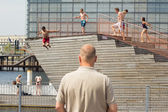 Children jumping in city pool — Stock Photo