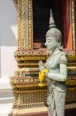 Angel statue with hands clasped in Thailand temple. — Stock Photo