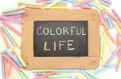Letter colorful life write on chalkboard — Stock Photo