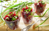 Fresh beetroot salad with bunch-onion in glasses — Stock Photo