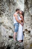 Young lovers man and woman walking in the mountains — Stock Photo