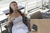 Beautiful young  girl resting after working in a caffe — Stock Photo