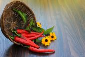 Hot pepper with flowers in a basket — Stock Photo